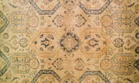 Tips And Strategies For Placing Area Rugs Over Carpeting